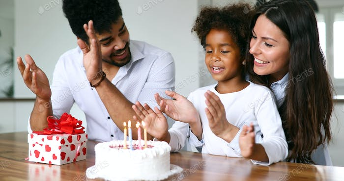 Happy family celebrating birthday of their child