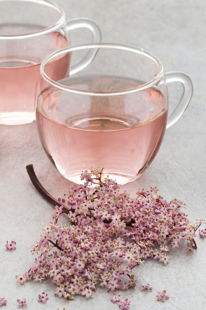 Cup of pink elderberry blossom tea