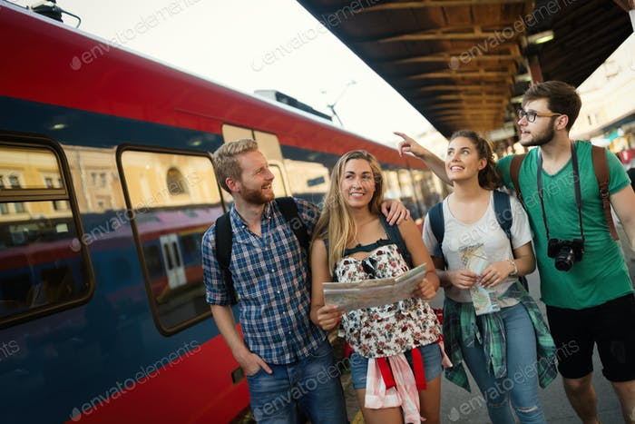 Young tourists travelling by train