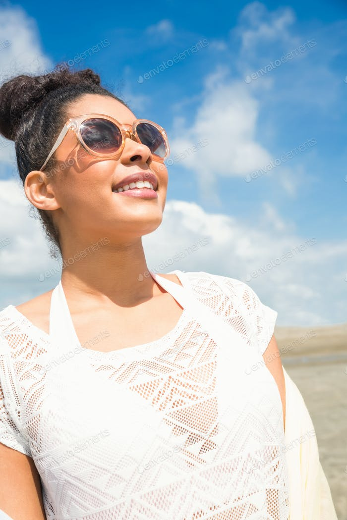 Stylish woman in sunglasses at the beach