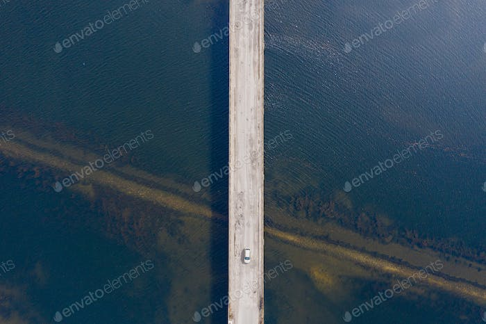 Aerial view of a bridge crossing the sea from a drone