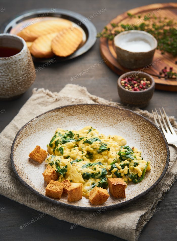 Scrambled eggs with spinach, cup of tea