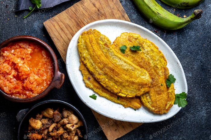 Colombian Caribbean Food. Patacon or Toston, Fried and Flattened Whole Green Plantain Banana