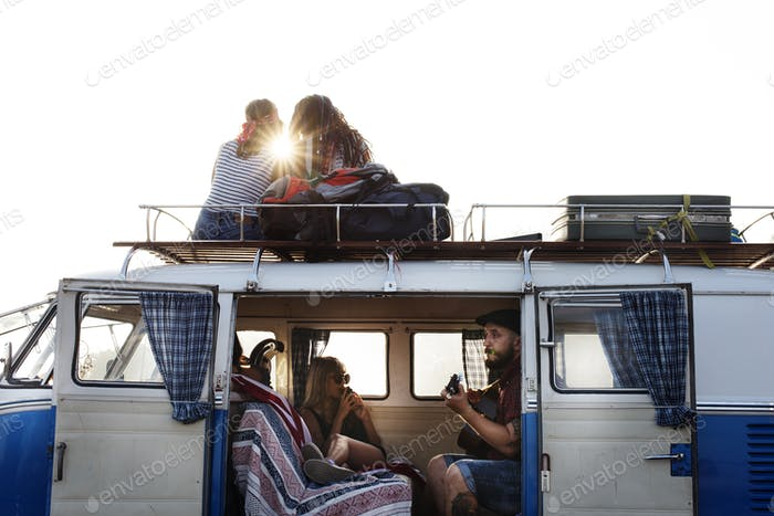 People Sitting on The Roof and inside of The Van on Road Trip Br