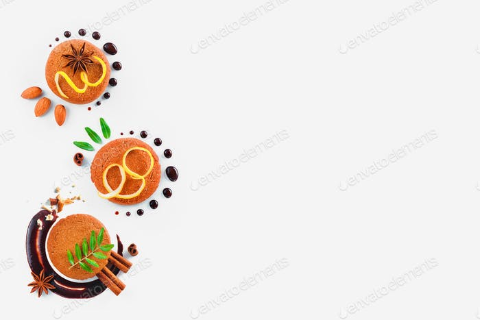 Header with a colorful pattern made of cookies, chocolate swooshes and rings, cinnamon, lemon zest