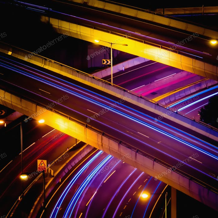 Abstract night view of highway interchange with moving cars. Hong Kong