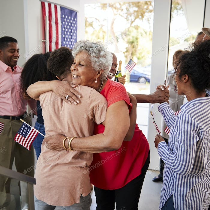 Senior black woman embracing her grandson at Independence Day family party,close up