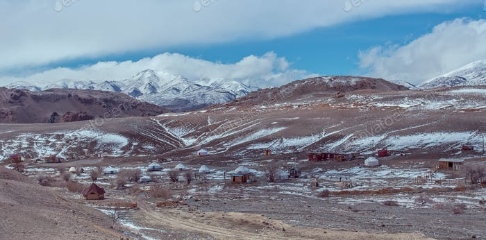 Altay gher campings under the snowy mountain
