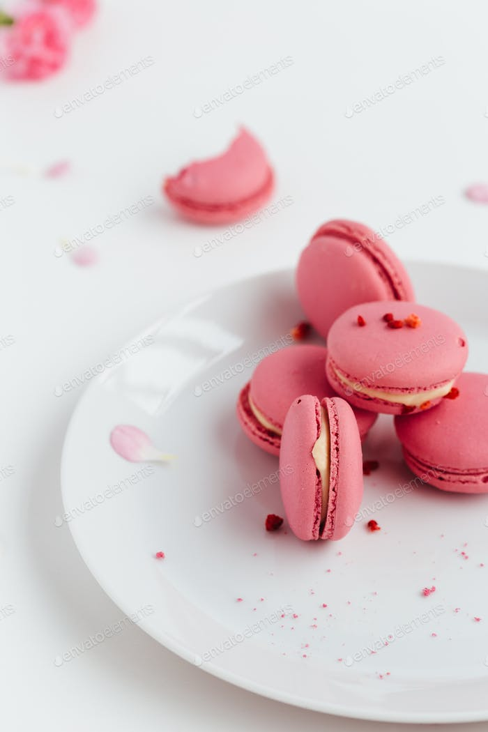 Pink Macarons Scattered on Table
