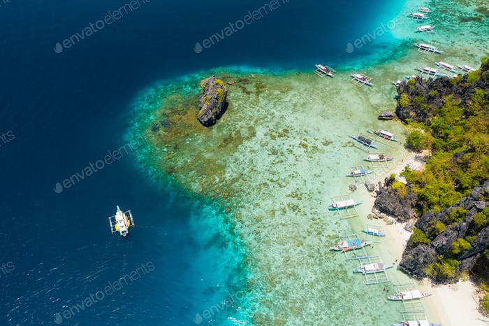 Shimizu Island, El Nido, Palawan, Philippines. Beautiful aerial view of tourist boat on trip close