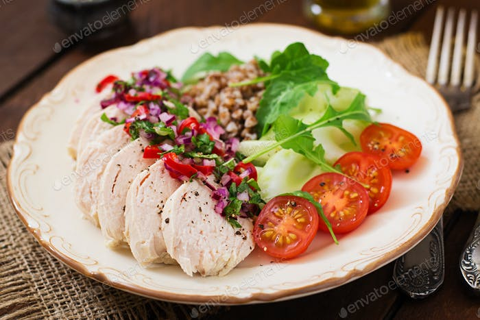 Diet food. Chicken breast with buckwheat and vegetables. Healthy lifestyle. Sports nutrition.