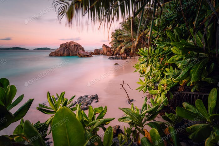 Paradise exotic beach on La Digue Island, Seychelles. Long Exposure during amazing sunset