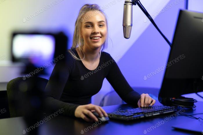 New Generation Female e-sport gamer streaming vlog online from office