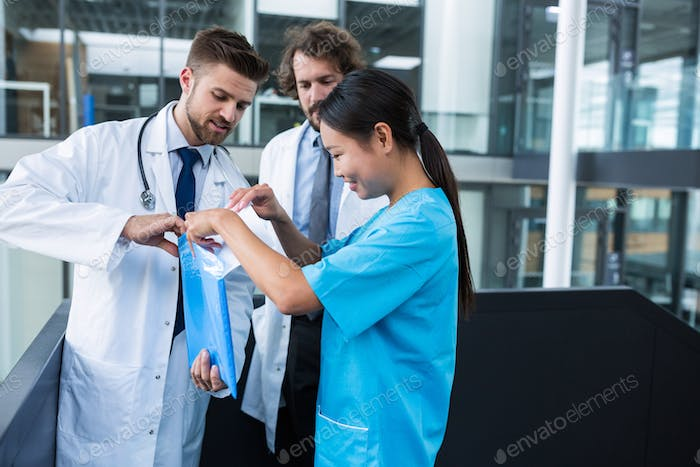 Doctor and nurse opening a file folder