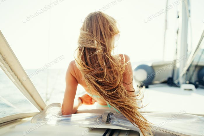 wind in hair yachting girl yachting on sailboat