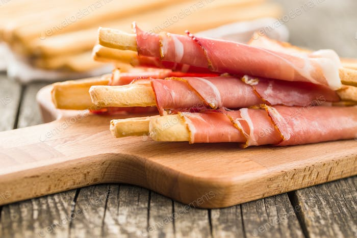 Parma ham prosciutto with grissini breadsticks.