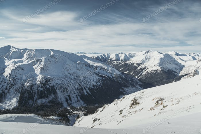 Aerial view of the snowy peaks of the Tatry mountains on the border of Poland and Slovakia