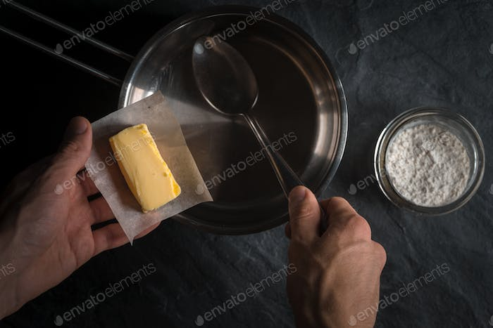 Hand put the butter in a bucket for making roux
