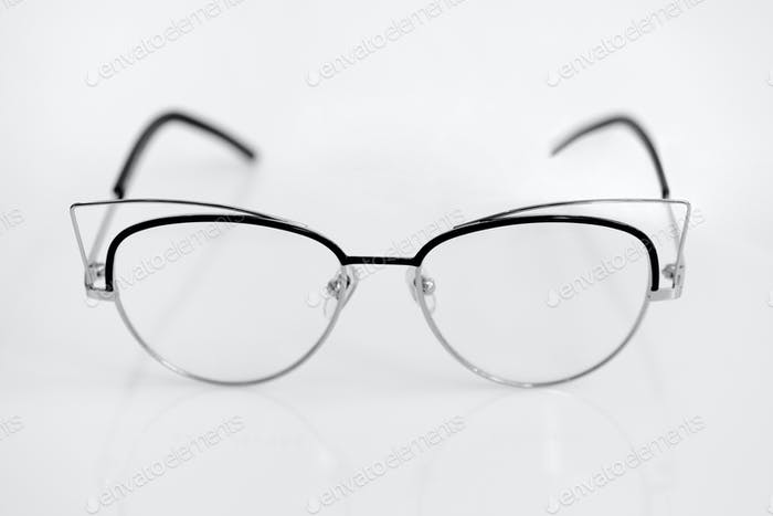 Eye glasses with clear lenses on the white background