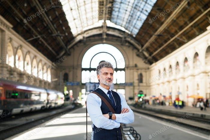 Mature businessman on a train station.