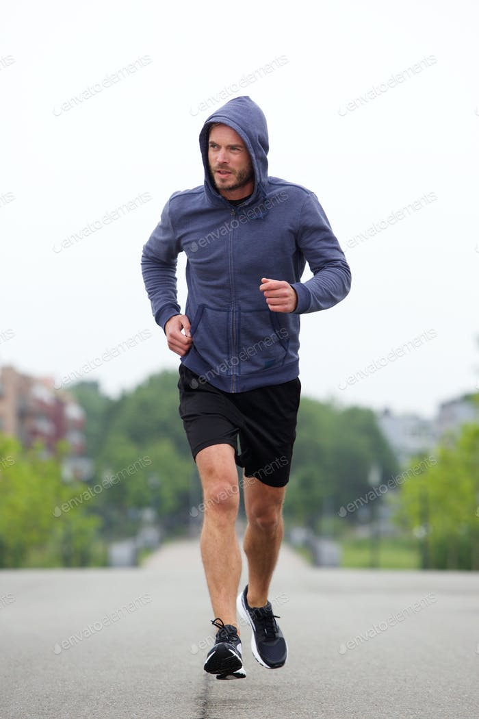 Beautiful carefree middle age runner outside