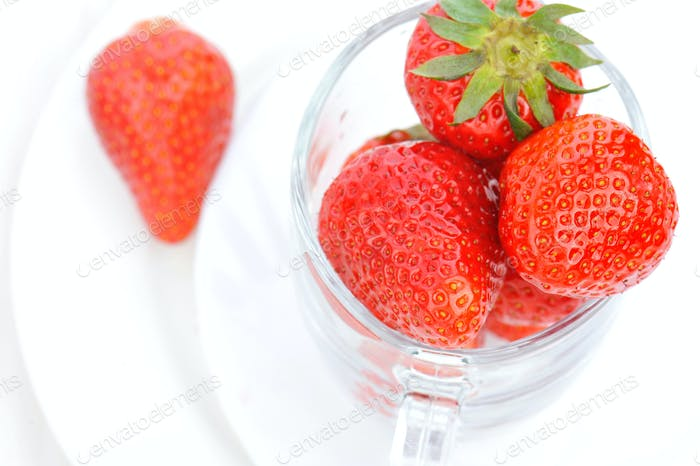 Strawberry. large berries in a jug. Close up view.
