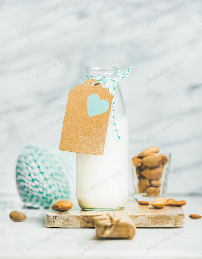Fresh vegan dairy-free almond milk with craft paper label