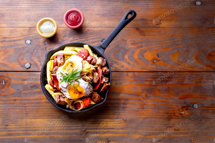 CHILEAN CHORRILLANA french fries topped with beef sliced chorrisos, fried onion and eggs