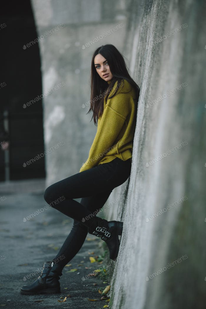 Fashion girl posing against wall