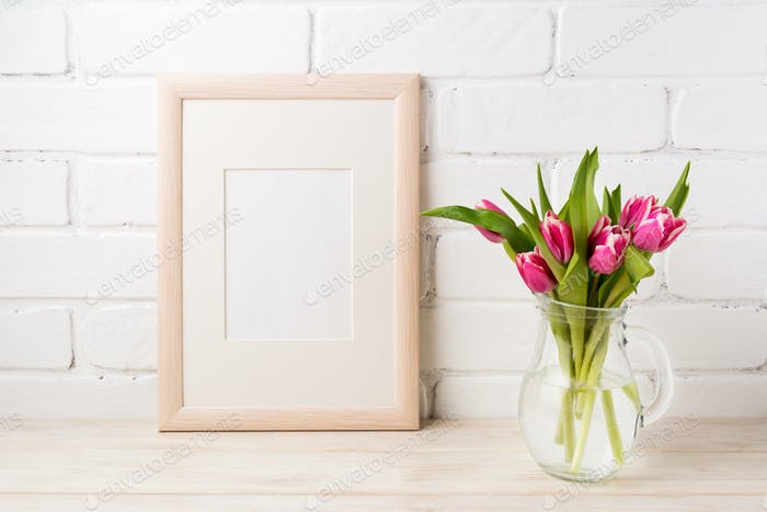 Wooden frame mockup with magenta pink tulips in glass pitcher ja