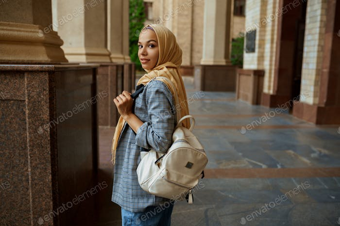 Arab student with books at university entrance