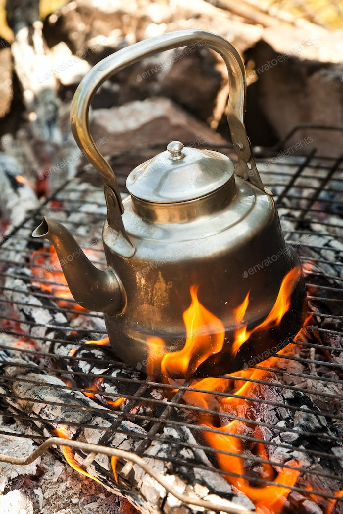 Kettle with water heated on the fire
