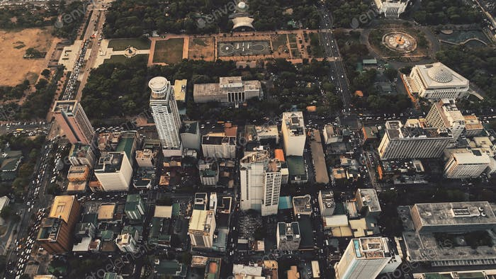Top down of skyscrapers roofs aerial. Cityscape of metropolis city Manila. Modern architecture