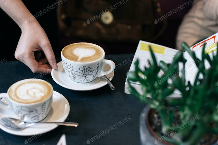 Two cups of cappuccino in cafe