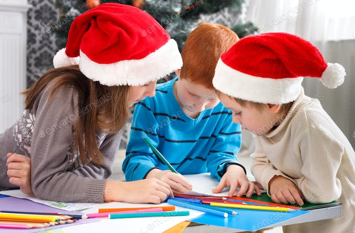 Children writing letter to santa, wait for christmas