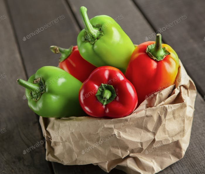 Organic fresh paprika in zero waste paper sack on wooden table