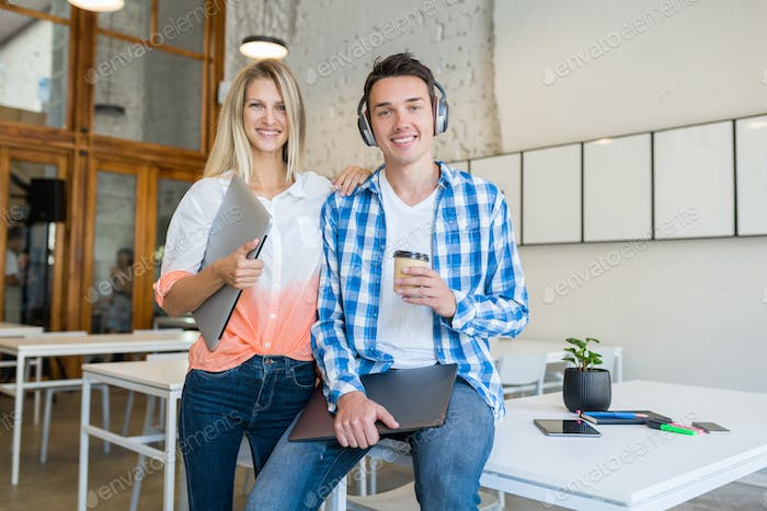 modern young stylish happy people in co-working office, startup freelancers