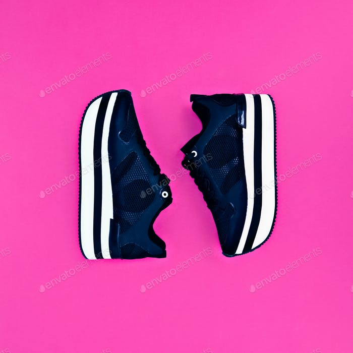 Stylish fashion sneakers on pink background. Glamour