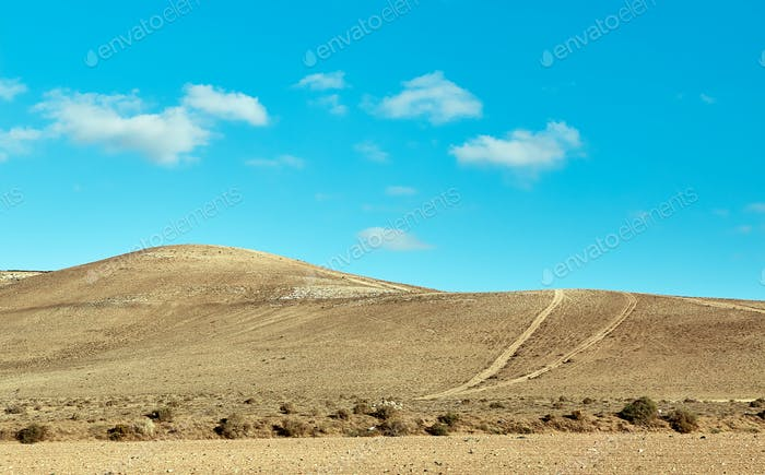 Volcanic hills and blue sky