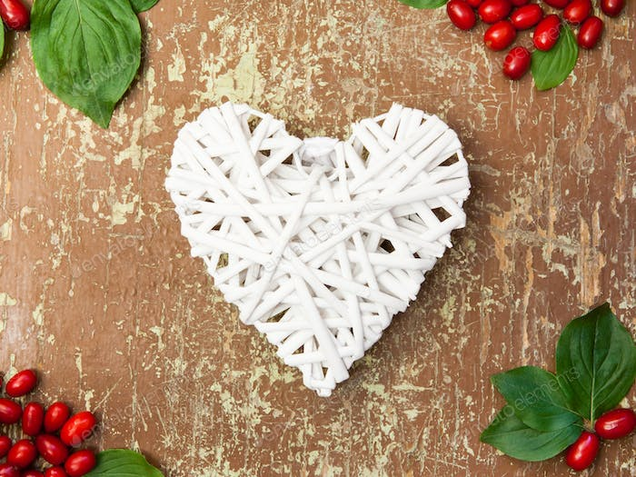 Red berries and white heart shape