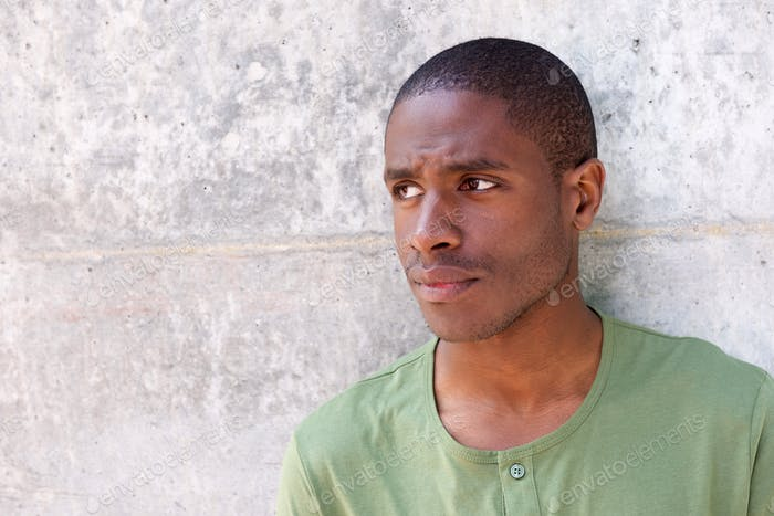 Handsome young black man looking away