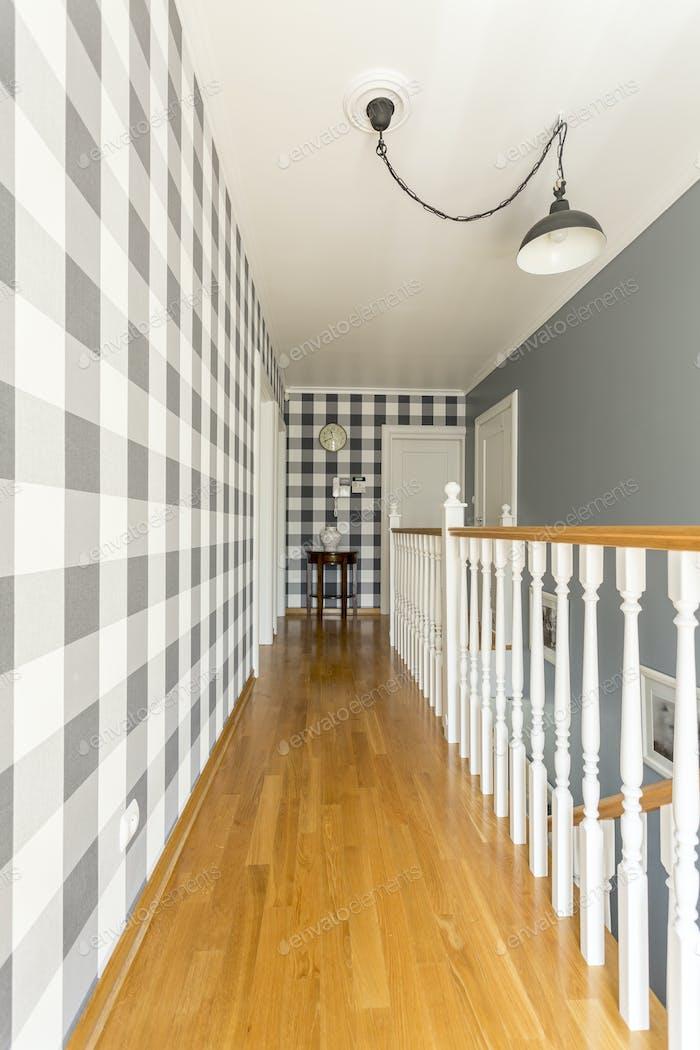 Spacious corridor with wooden staircase