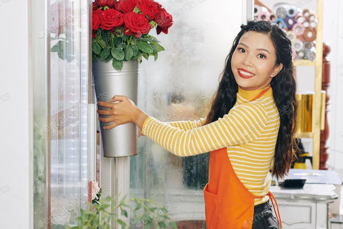 Florist with bucket of roses