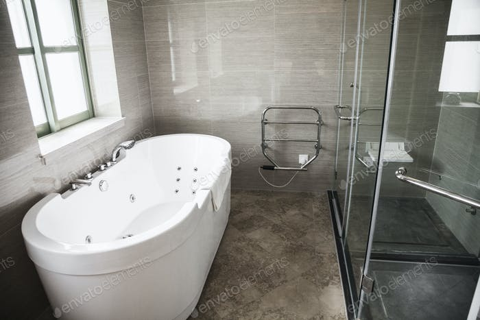 Modern, clean, bathroom with bathtub and shower.