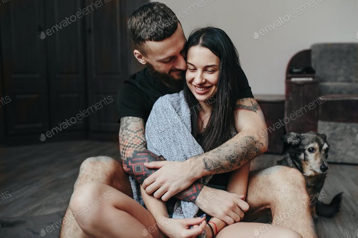 couple relaxing on the floor in the room