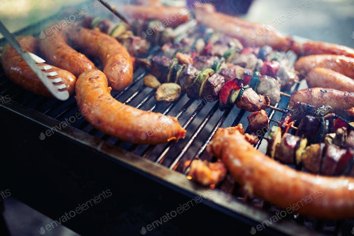 Grilled meat with vegetables over the coal on barbecue