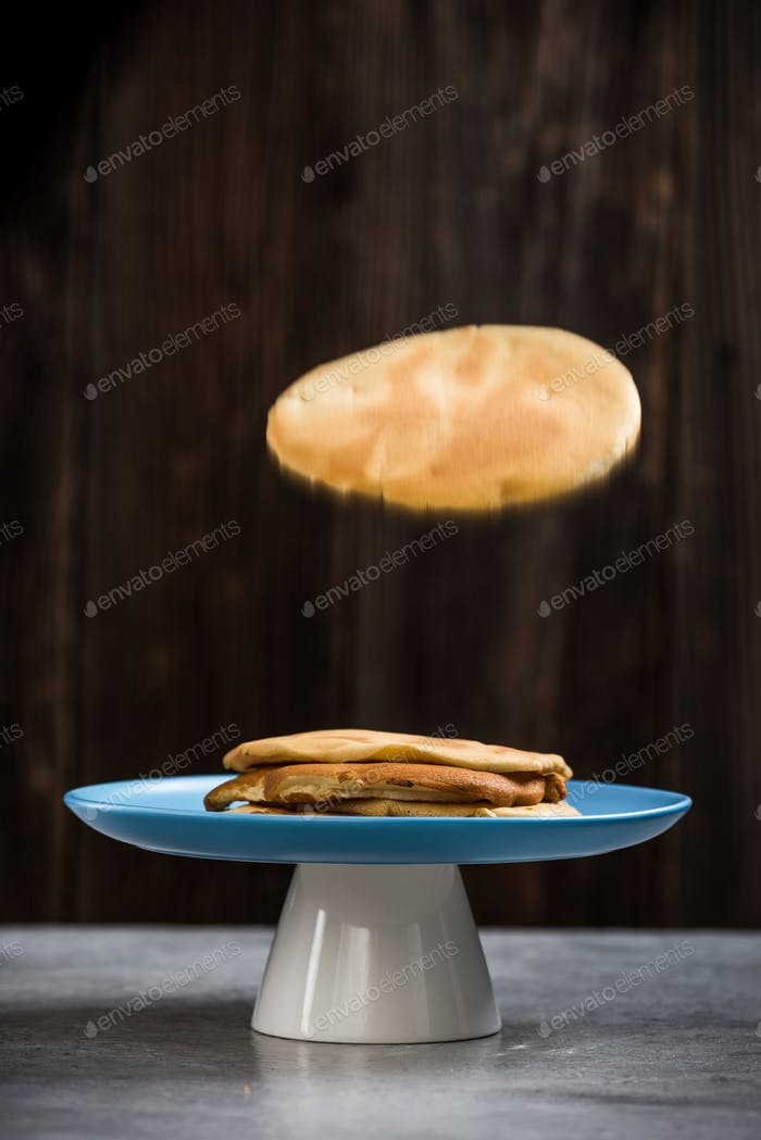 Pancake flying into plate