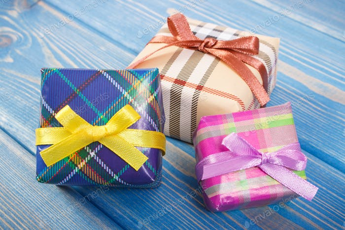 Wrapped colorful gifts with ribbons for Christmas festive time or other celebration