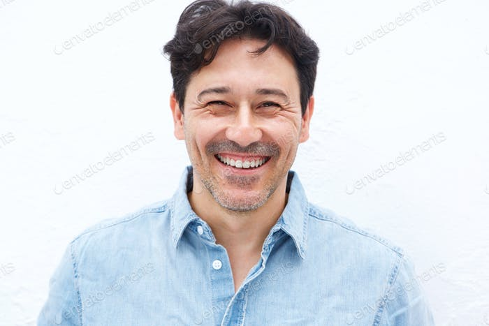 handsome mature guy smiling against white background