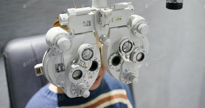 Woman checks her eyes at optometrist